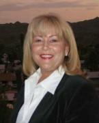Portrait photograph of Barbara McGuire.